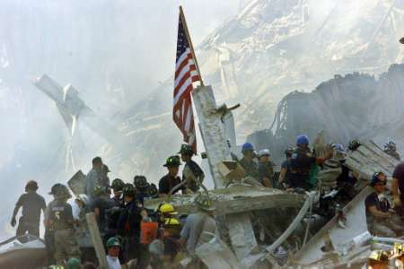 Rescue workers try to save lives after the 9/11 attack on the World Trade Center